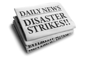 newspaper headline of disaster